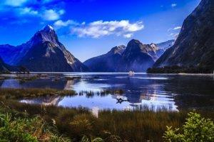 Milford Sound, New Zealand. Mountains with reflective lake.