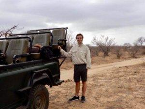 Christopher next to our safari vehicle in all of his safari gear