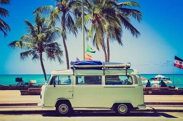Trip Planning Resources: Van in front of beach.