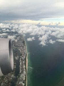 plane engine going over clouds and sea