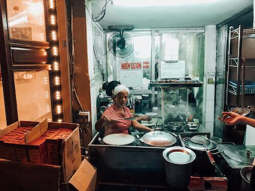 Hanoi Street Food Tour rice crepe lady