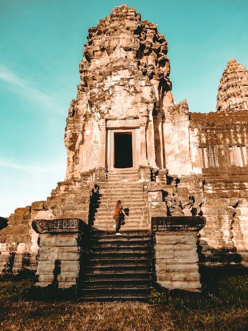 Kat climbing an outer tower of Angkor Wat