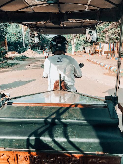 Riding on the back of a tuk tuk