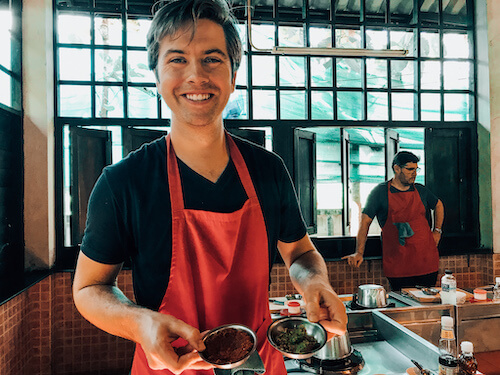 Chris showing his curry paste at Thai Farm Cooking School
