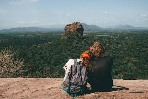 Couples overlooking rock monument in Sri Lanka