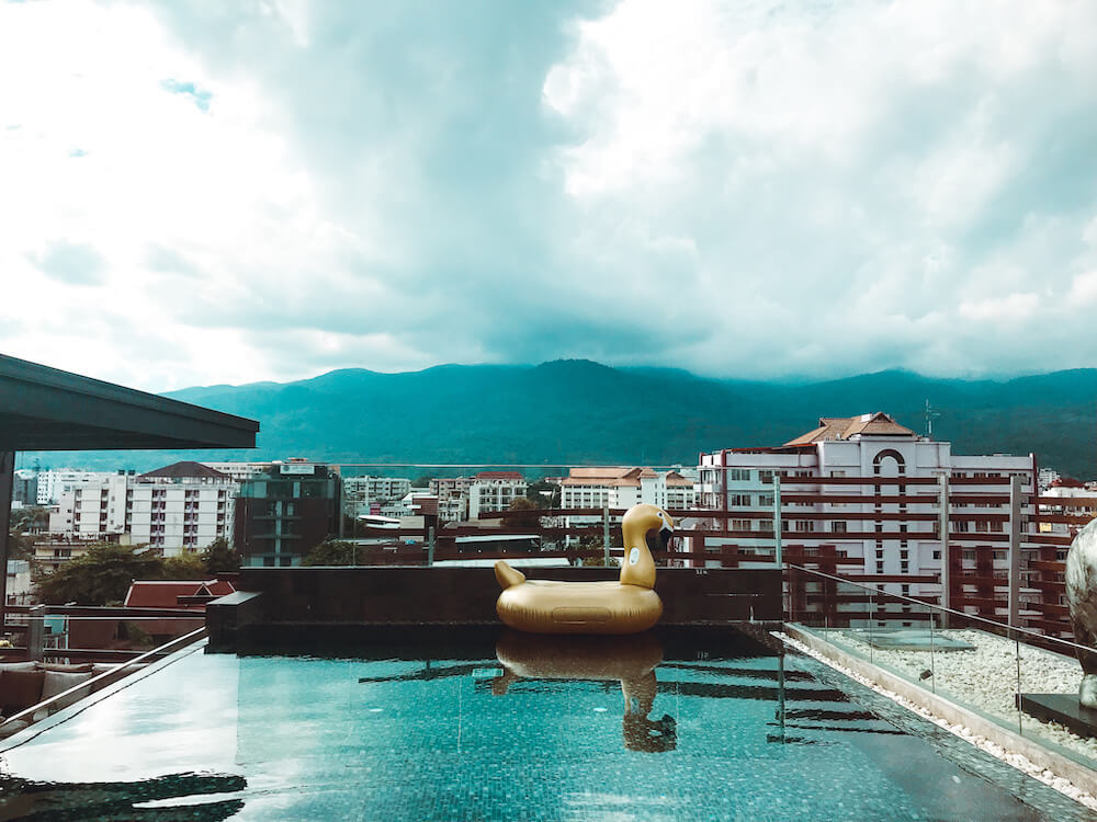 Akyra Manor Chiang Mai rooftop pool overlooking mountains