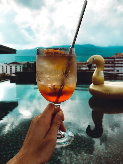 Akyra Manor rooftop pool with Aperol Spritz
