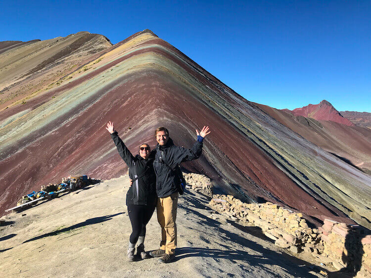 Kat and Chris celebrating in front of Rainbow Mountain, Peru - Peru itinerary