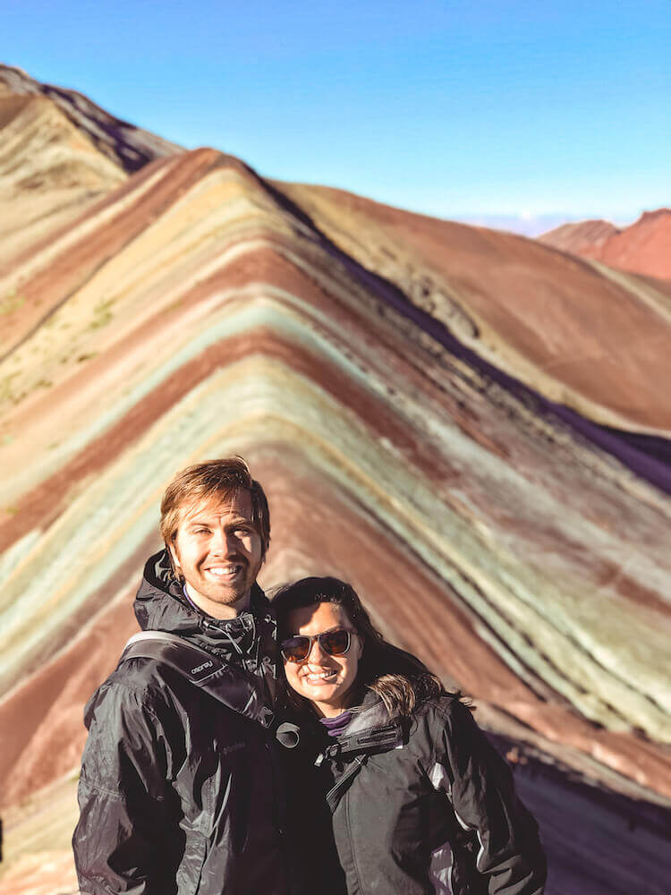 Kat and Chris smiling in front of Rainbow Mountain, Peru - Peru itinerary