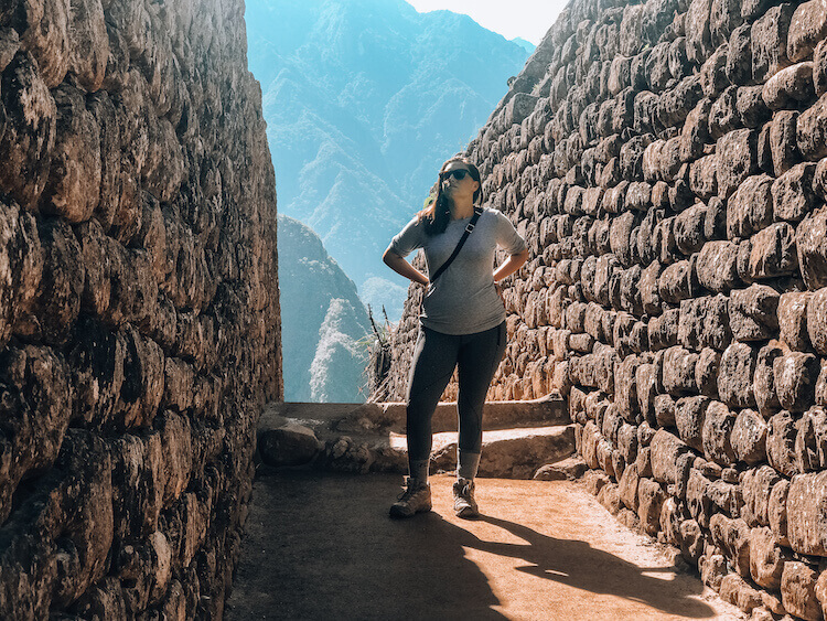 Kat exploring the ruins of Machu Picchu - Peru itinerary