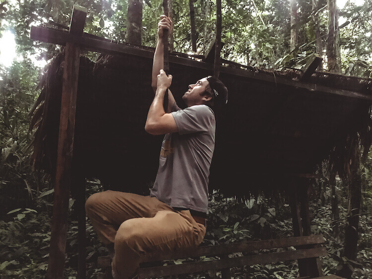Chris swinging on a vine in the Tambopata National Reserve in the Amazon in Peru - Peru Amazon