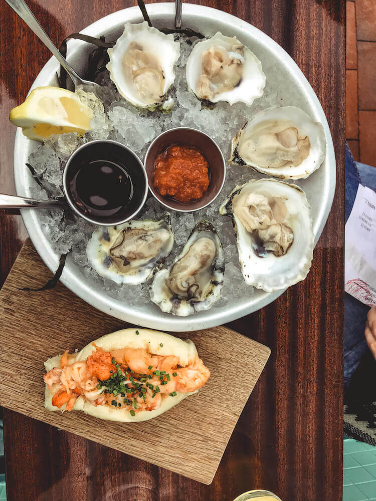 oysters and lobster roll at Eventide Oyster Co - Best Lobster rolls in Portland Maine