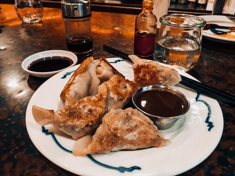 potstickers with sauce at Bao Bao - Best food in Portland Maine