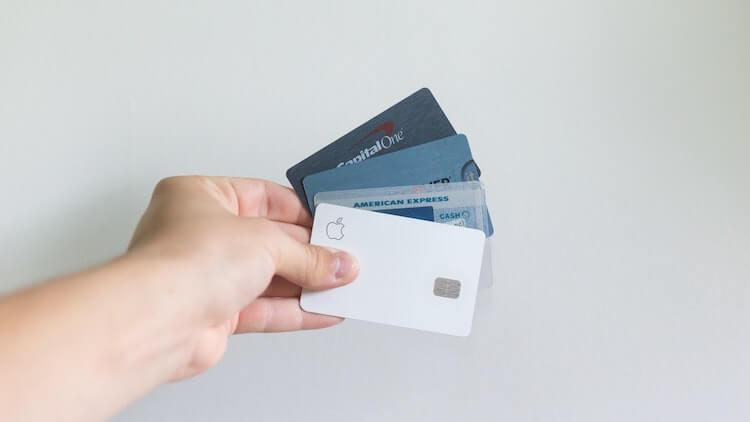 Several Credit Cards held in person's hand
