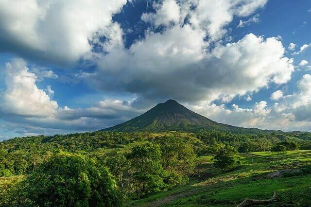 green volcano surrounded by dense forest Costa Rica. Where to honeymoon based on your travel style