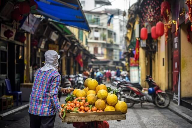 Man carting fruit in Hanoi