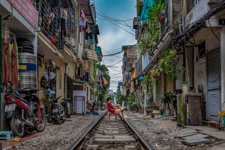 Person lounged on train street in Hanoi in a day