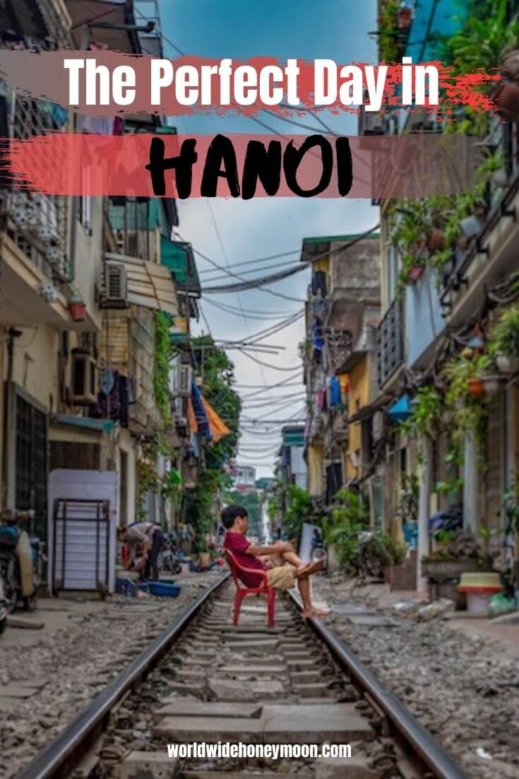 The Perfect Day in Hanoi | Person sitting on the train tracks in a red chair