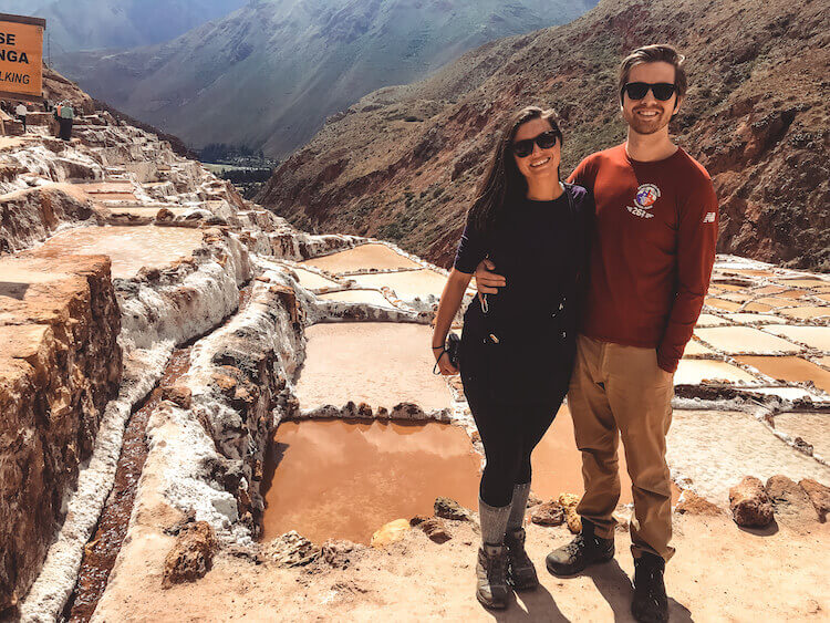 Kat and Chris exploring the Maras Salt Mines in Peru - 10-day Peru itinerary