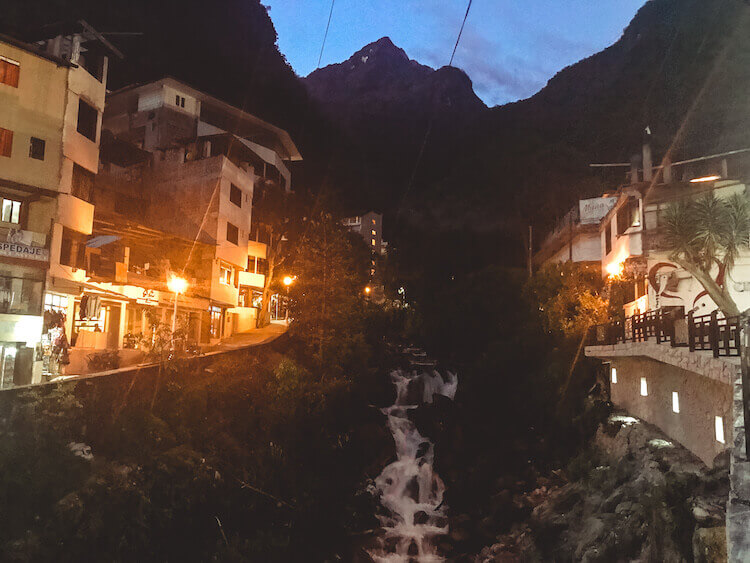 Aguas Calientes, Peru at night with the bridge and waterfalls