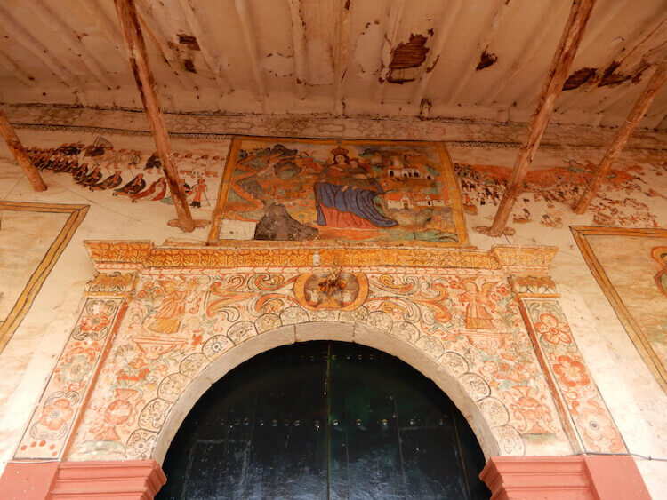 Entrance to Cathedral with intricate paintings in Chinchero, Sacred Valley, Peru