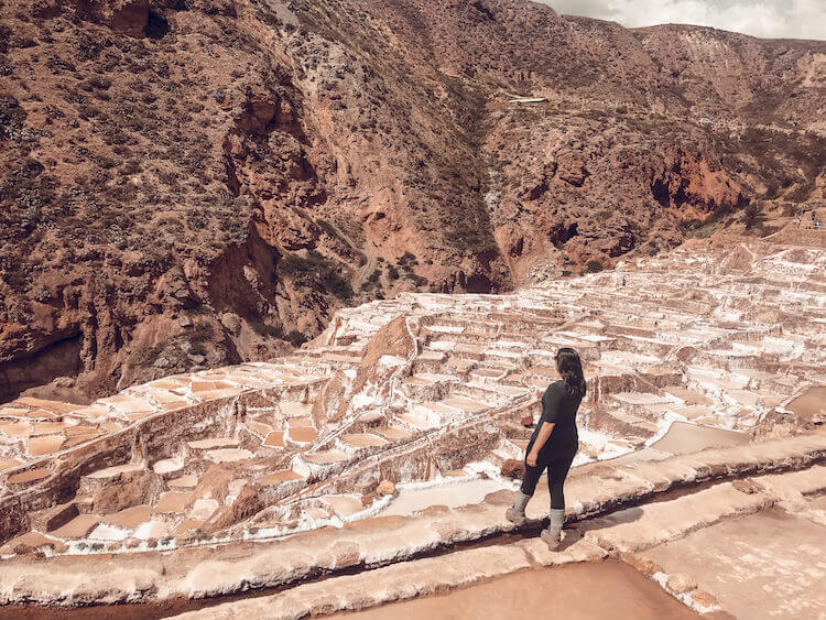 Kat exploring the salt pools at the Maras Salt Mines in the Sacred Valley