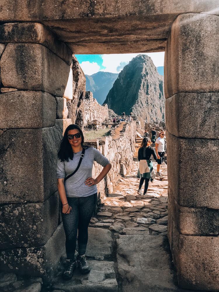 Kat posing at the entrance of Machu Picchu