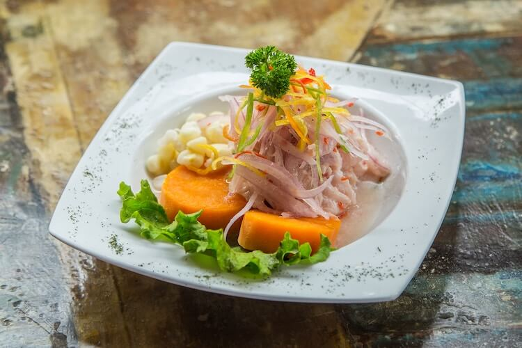 plate of ceviche with sweet potato and corn