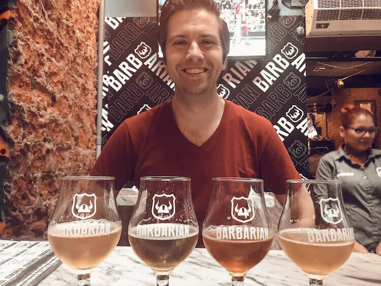 Chris and his beer flight at Barbarian in Peru