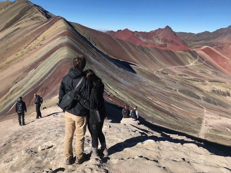 Kat and Chris looking at Rainbow Mountain