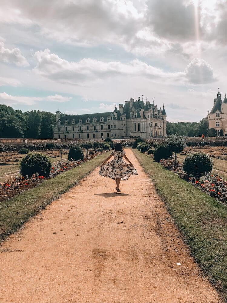 Kat running through gardens at Chateau de Chenonceau