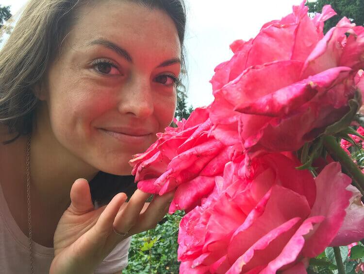 Kat smelling roses at the International Rose Test Garden