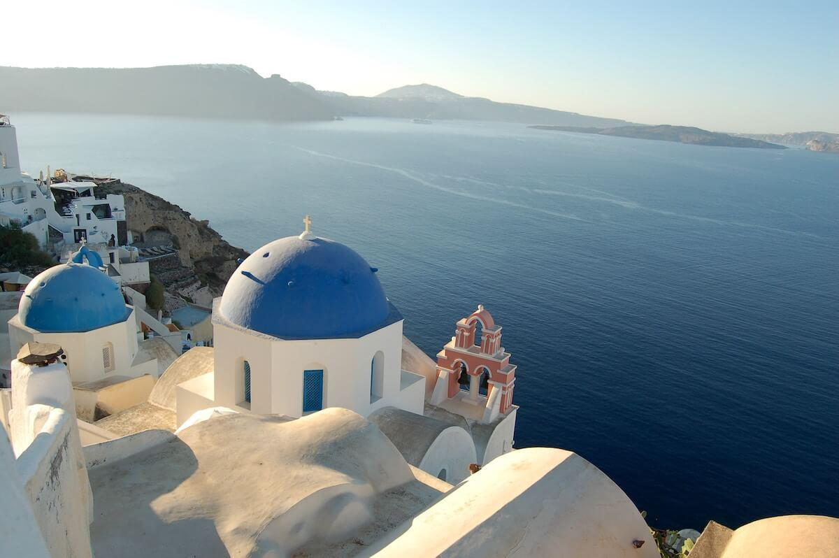 Domed blue churches in Oia, Santorini, Greece during a Perfect Greece Itinerary in 7 Days