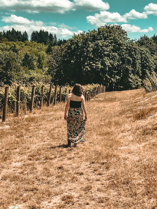Kat wandering through the vineyards on her day trip from Portland