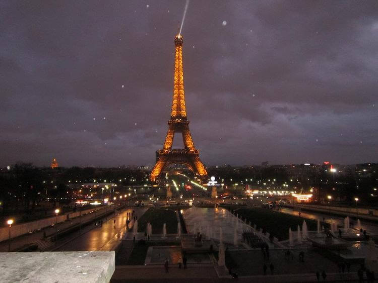 Paris in January- Eiffel Tower lit up with snow