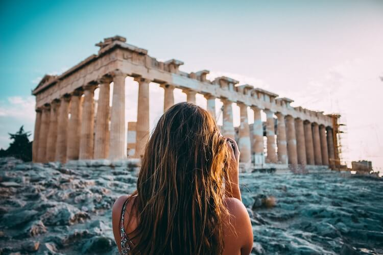 woman in front of the Acropolis