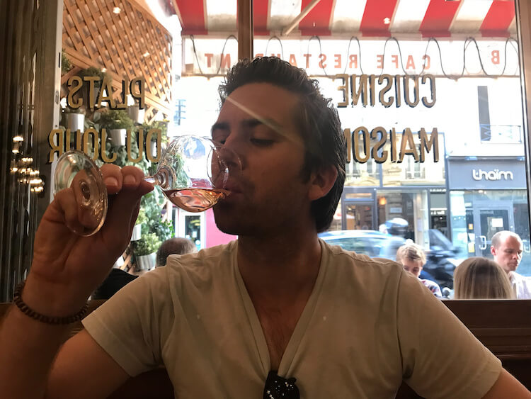Chris enjoying a glass of rose- Trip to Paris Cost