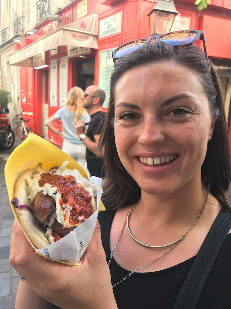 Kat with a falafel in Paris- cheap eats in Paris