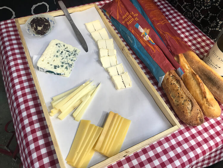 Sampling cheese and baguettes on our Paris Secret Food Tour