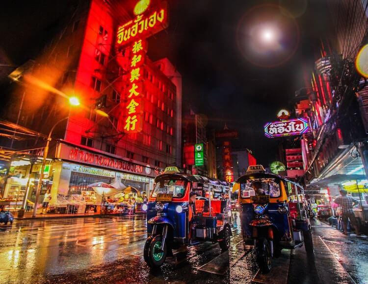 Tuk tuks on a busy street in Bangkok