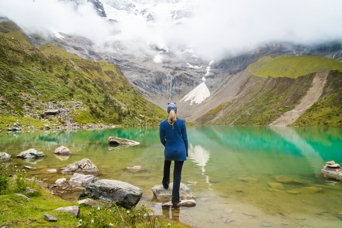Woman hiking Humantay Lake in Peru as a day trip from Cusco