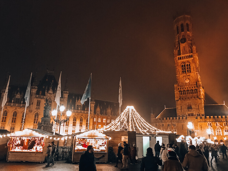 Bruges Christmas market in the Grotemarkt with the Belfry in the background