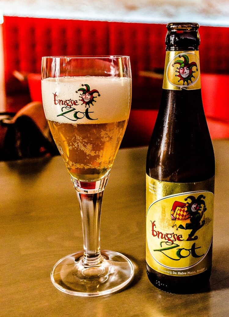 Brugse Zot bottle and glass