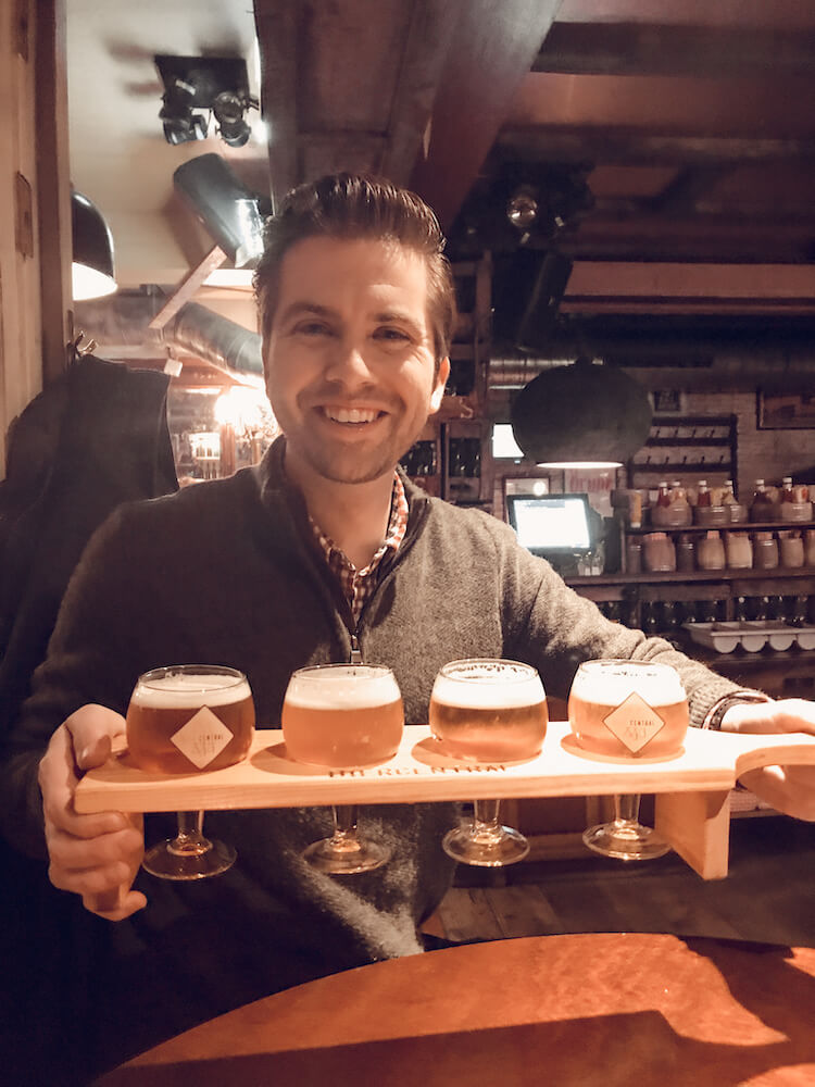 Chris with his flight of beer at Bier Central - Where to drink beer in Antwerp