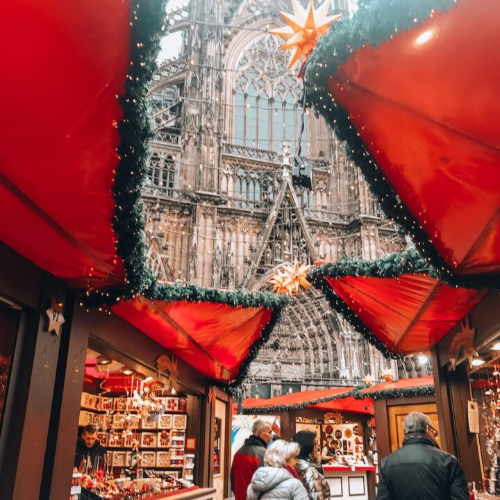 Cologne Cathedral Christmas Market next to the cathedral and under Christmas lights - Christmas Markets in Cologne Germany - Best Christmas Markets in Cologne