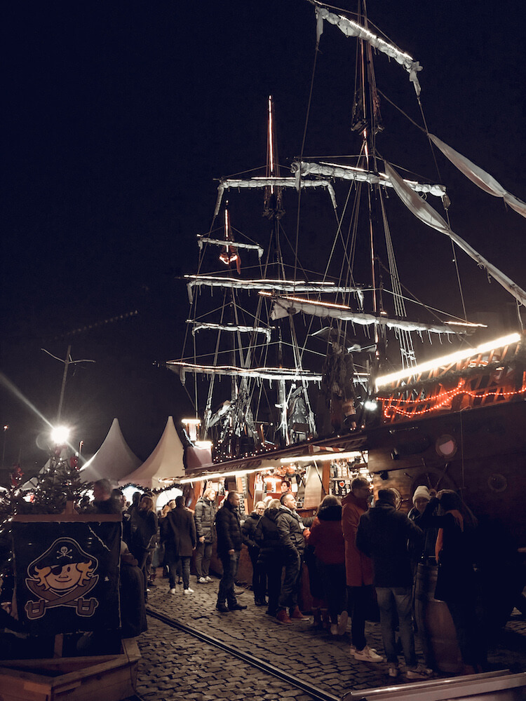 Gluhwein stand ship at the Harbor Christmas Market in Cologne Germany