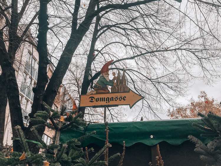 Gnome on a sign at the Alter Market Christmas market in Cologne - Christmas Markets in Cologne Germany