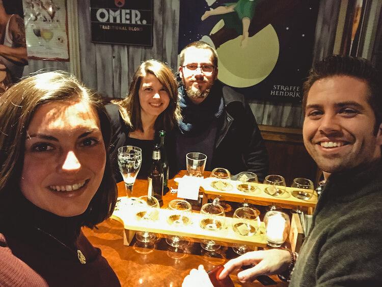Kat and Chris with their Belgian friends enjoying their beer flights in Antwerp - Where to Drink Beer in Antwerp