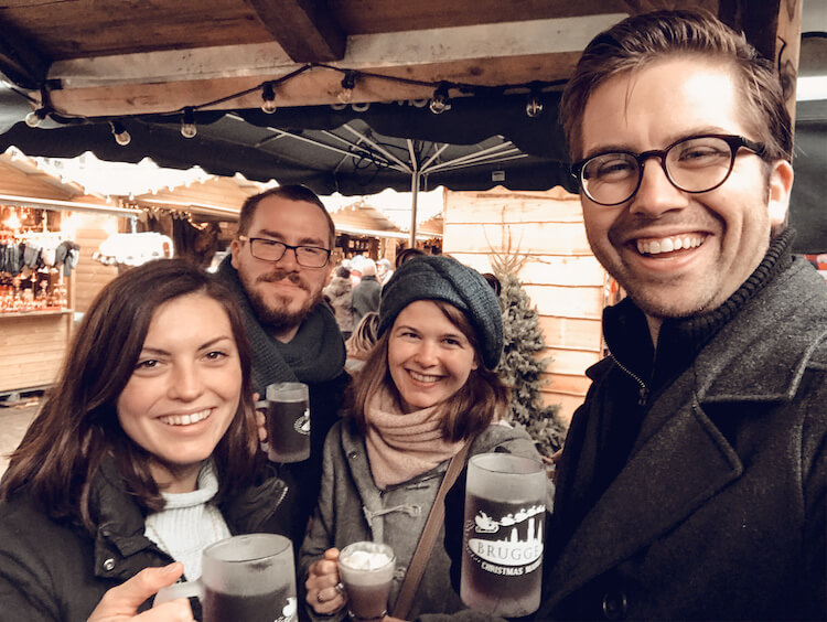 Kat and Chris with their friends at the Bruges Christmas market
