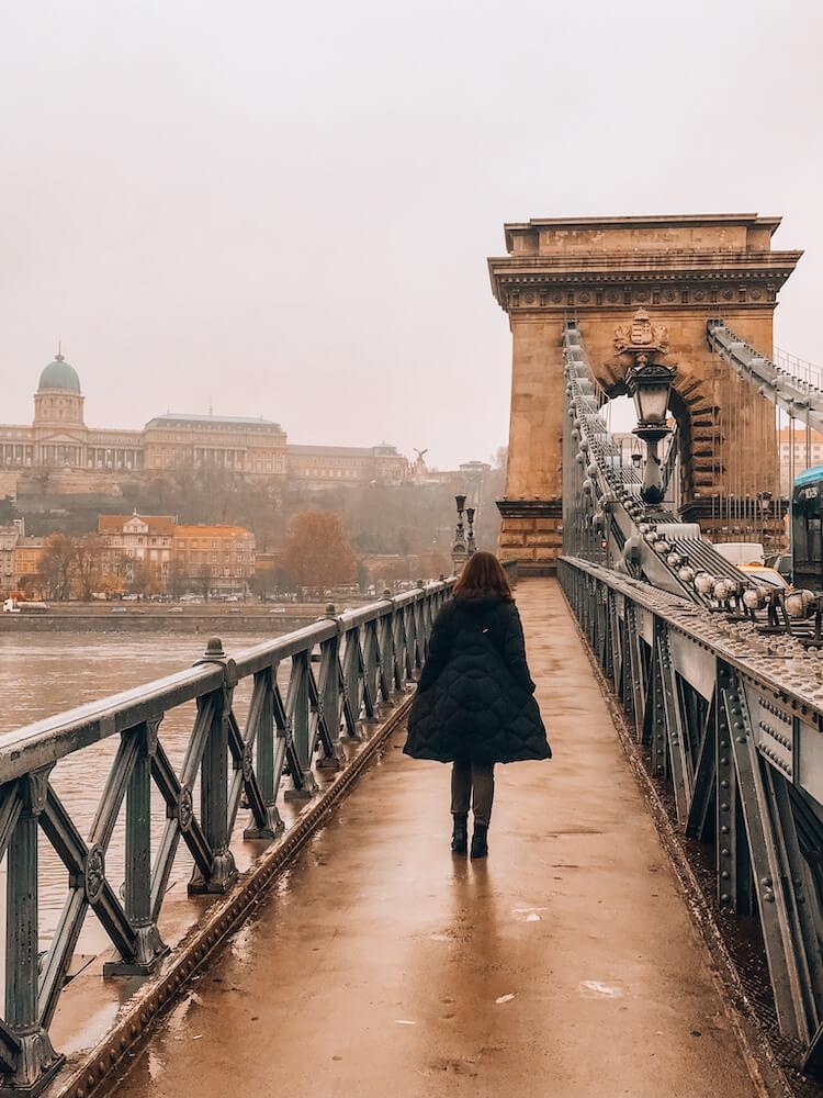 Kat crossing the Chain Bridge on a hazy morning